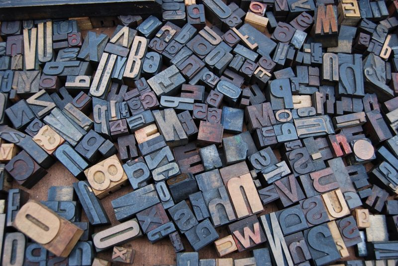 A jumble of rubber stamps featuring numbers and letters.