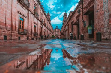 colonial pink sandstone buildings in Mexico.