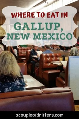 People sitting in booths at a diner in Gallup, New Mexico eating food.